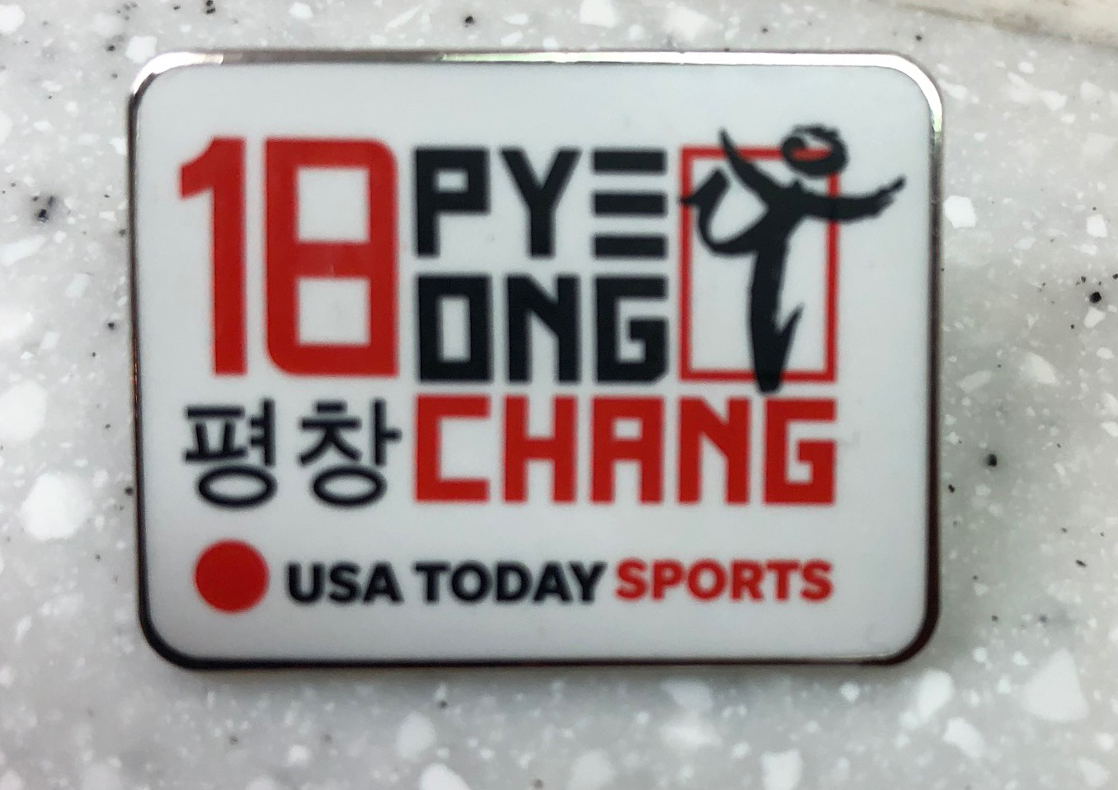 USA Today Sports pin Acquired: Trade with Korean volunteer.  Thoughts: Better that most. I like that it's specific to these Olympics, specific to an organization and that it has an athlete. I think that's an athlete, right? Maybe an ice skater? Or an ice runner?  Rating: 8