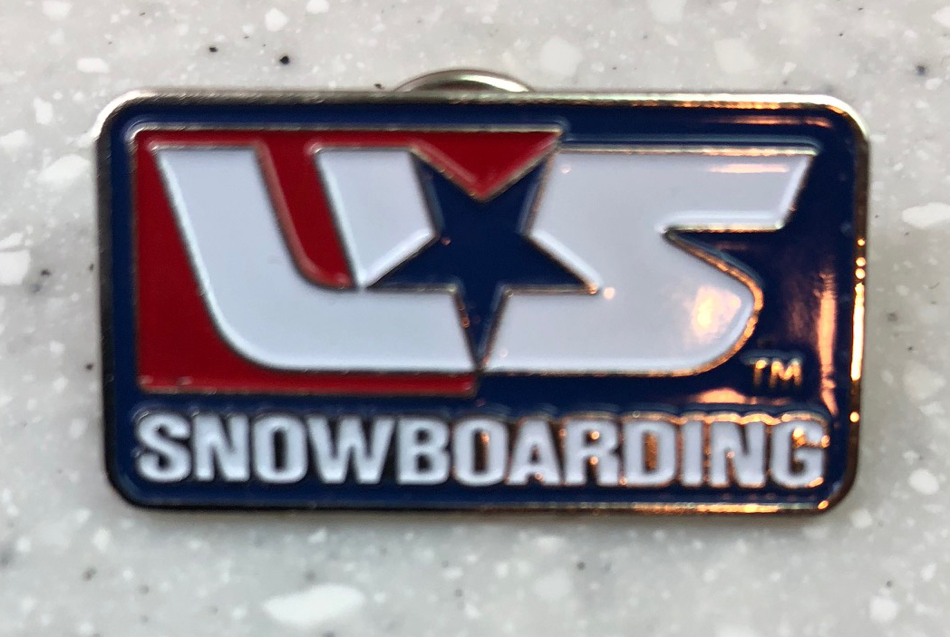 US Snowboarding pin: Acquired: From a Korean volunteer Thoughts: It's pretty basic, but I liked it. I was looking to trade with volunteers at the final Nordic combined event and made this trade while preparing to board the tram that takes judges, workers and photographers up to the top of the jumps. She didn't have a ton of options to trade back, but this was fine with me. It's an old design, but classic USA. Rating: 4