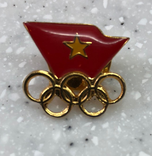 Vietnam flag pin Acquired: Pin trader outside Main Press Center at Alpensia Ski Resort Thoughts: This was one of my first trades. Several pin traders posted up outside the Main Press Center —MPC in Olympics journalism lingo — and I stopped and made a quick trade. He only had about eight pins he was willing to swap. He had a few that were Pyeongchang 2018 pins, which I would have gone for, but I'm traveling to Vietnam with several friends after the Olympics, so I thought this was appropriate. Rating: 6