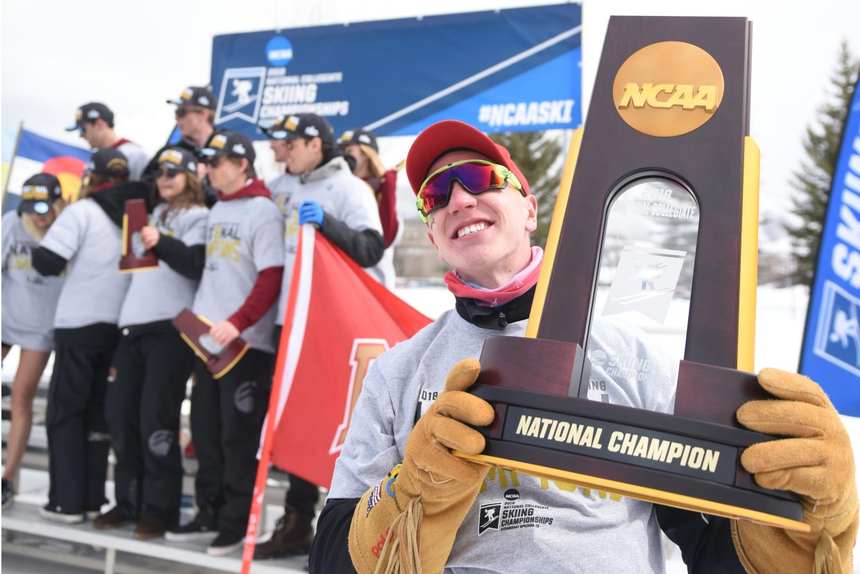 DU skier Lars Hannah, from Steamboat Springs, hoists the NCAA championship trophy on Saturday after the Pioneers won their 24th title.