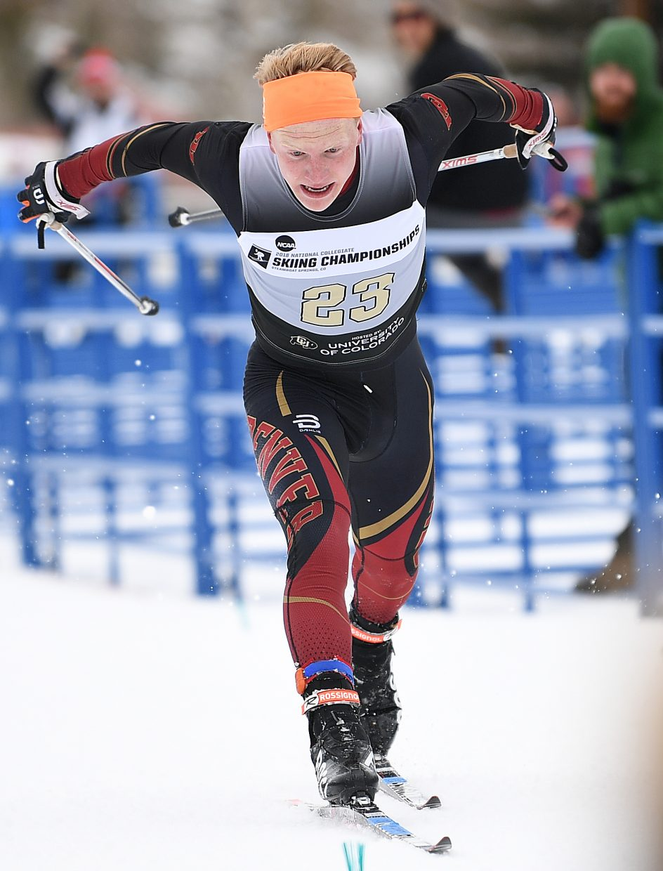 DU skier Lars Hannah, from Steamboat Springs, lunges across the finish line of the NCAA Championships mens 20-kilometer freestyle cross-country ski race Saturday at Howelsen Hill in Steamboat Springs.