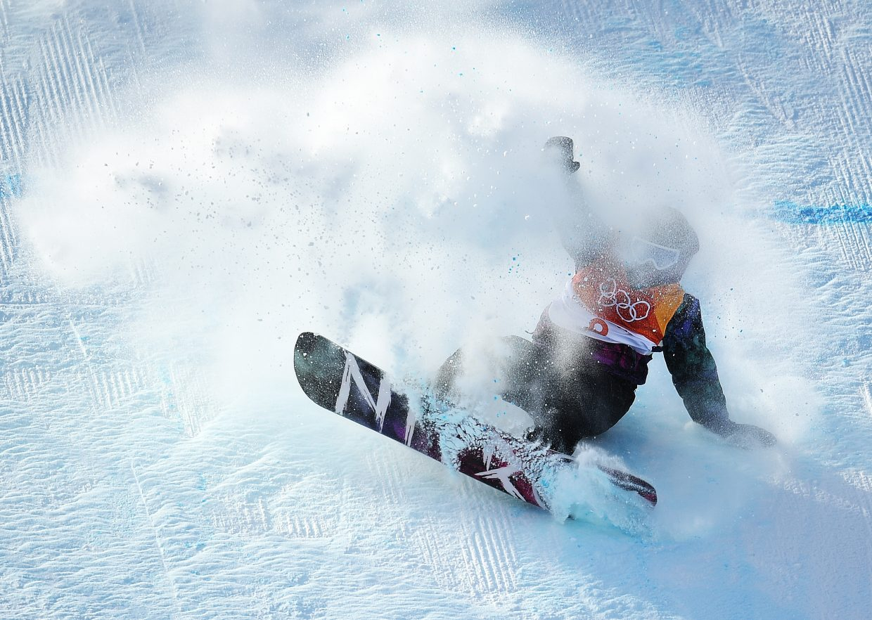 Norway's Torgier Bergrem slides out of his landing during the men's snowboard slopestyle competition.