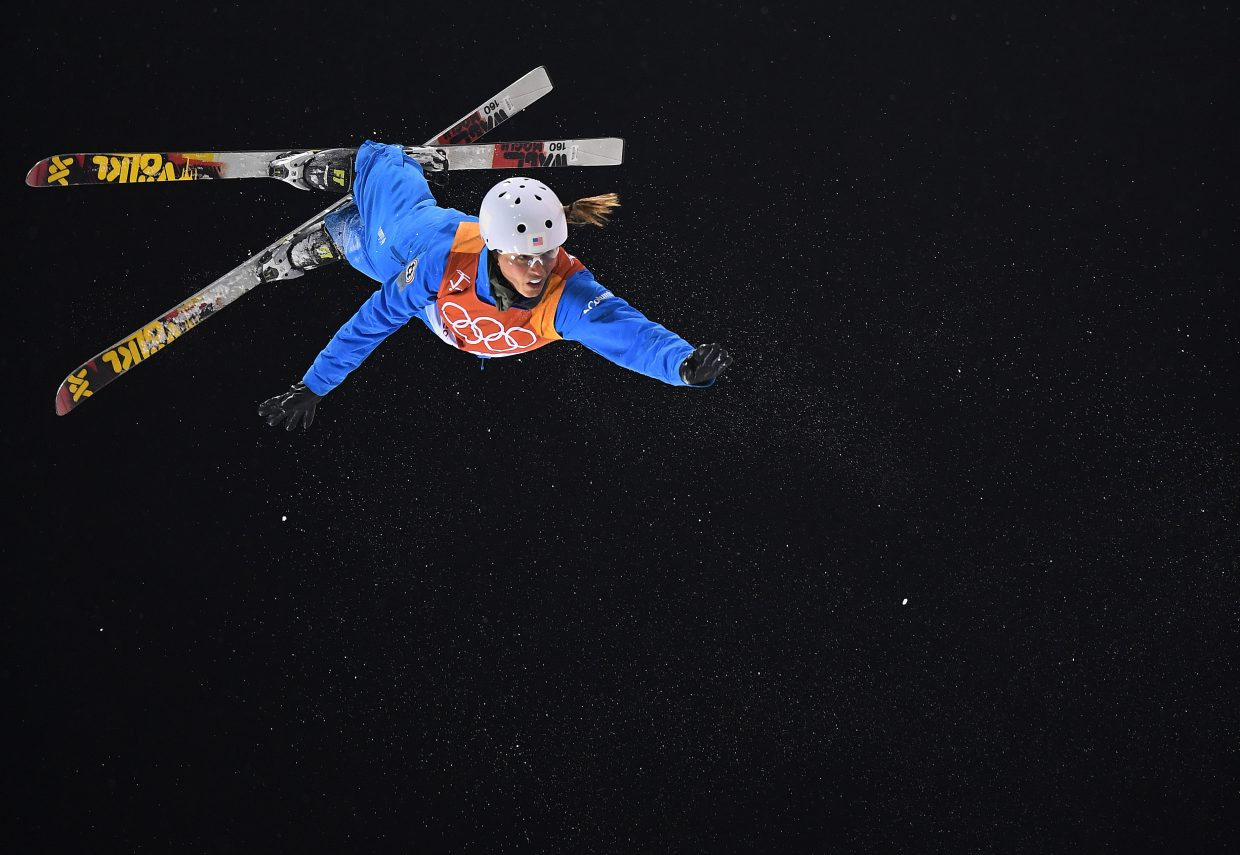 Madison Olsen flies high in the night sky above Phoenix Snow Park in Pyeongchang, South Korea during the women's aerials finals.