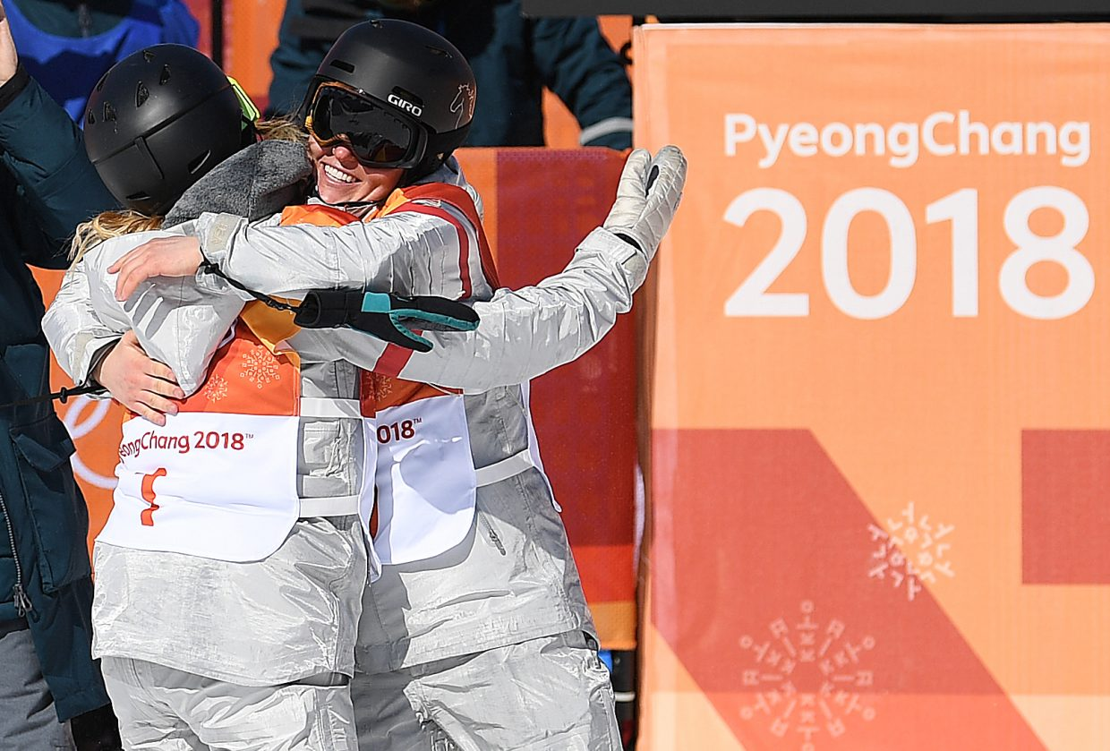 Women's halfpipe snowboarders Arielle Gold and Chloe Kim are close friends and I loved this shot of them sharing their joy after each locked up a medal at this year's Olympics.