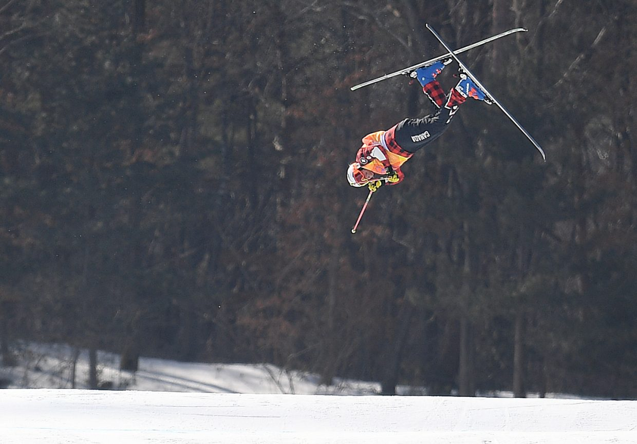 Canadian ski cross racer Chris Delbosco flies off the course and out of the Olympics during an early men's ski cross heat.