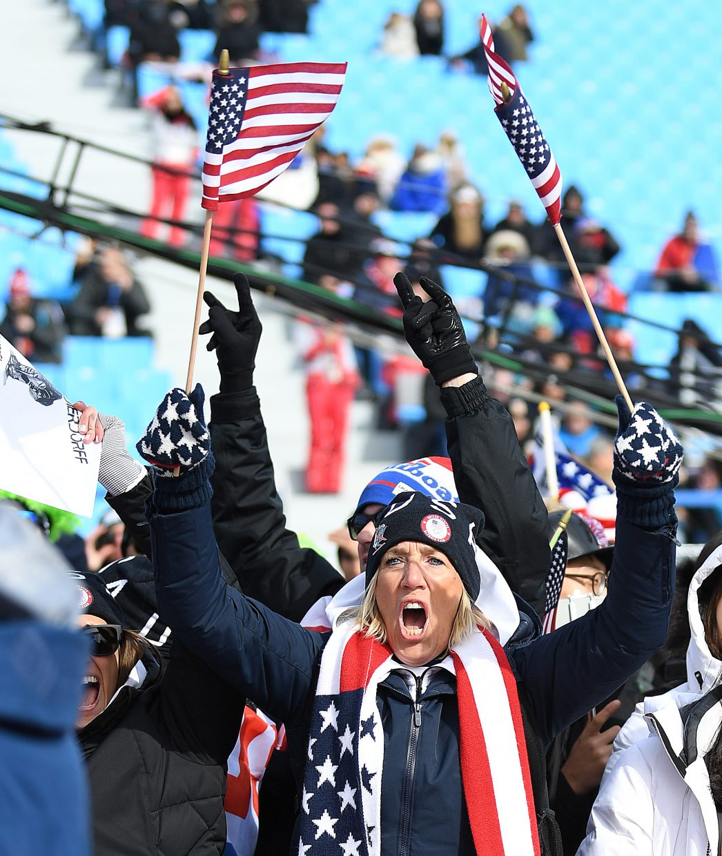 Mary Dierdorff cheers on her son, Mick, in the men's snowboard cross event at the 2018 Winter Olympics. Emotion is thing about the Olympics and there's plenty of that in this shot.