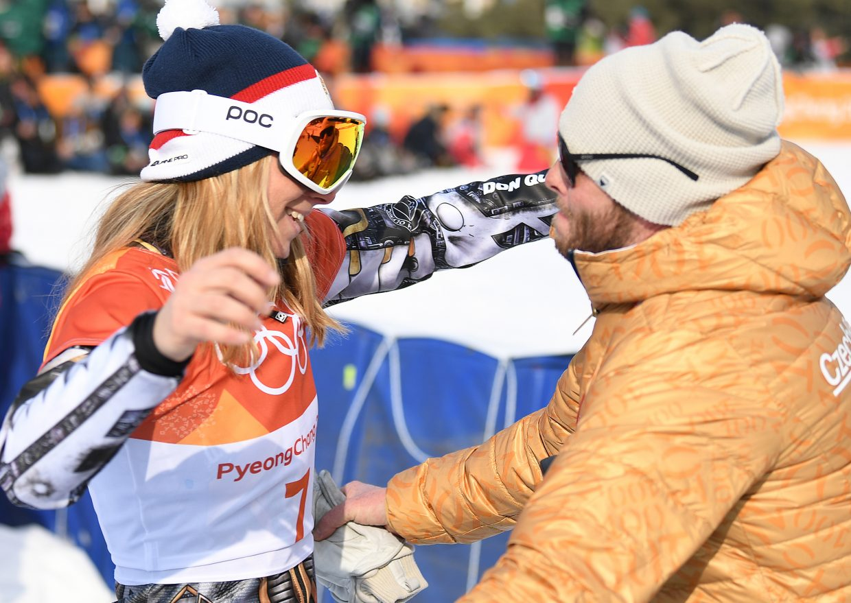Ester Ledecká and Justin Reiter come togethr for a hug to celebrate after she won the gold medal in women's snowboarding parallel giant slalom. The first thing I love about this shot is I was the only one who had it. I was interviewing Reiter, who lives in Steamboat Springs, when Ledecka, who's trained in Steamboat, ran up to give out a well-deserved hug after winning her second gold medal of the Olympics. I was lucky to have my camera at my side and snapped a series of shots. Hugs are hard to shoot because you usually would want to see both faces. I decided I liked this particular shot because, even though you don't get a good, direct view of Reiter's face, you can see it reflected in Ledecka's goggles.