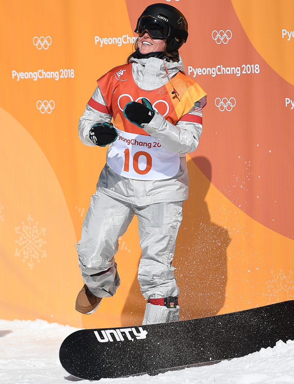 Arielle Gold celebrates her bronze medal run at the 2018 Winter Olympics in South Korea. A big internal debate in photographing the Olympics is whether to linger at the bottom of the course to get reaction shots at the finish line, or to hike up and get higher-quality action shots. I decided to wait at the bottom. That decision allowed me to get a good spot before the crowd of photographers came down from the halfpipe, and it allowed me to get this shot, of the moment Gold found out she had flown into medal position.