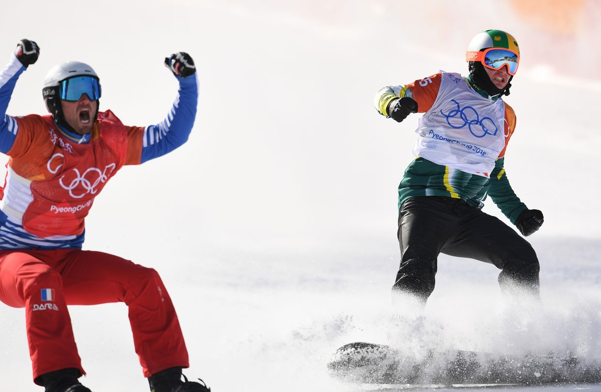 Jarryd Hughes, right, celebrates winning a silver medal in the men's snowboard cross event at the 2018 Winter Olympics in Pyeongchang, South Korea next to the event's gold medalist, Pierre Vaultier of France.