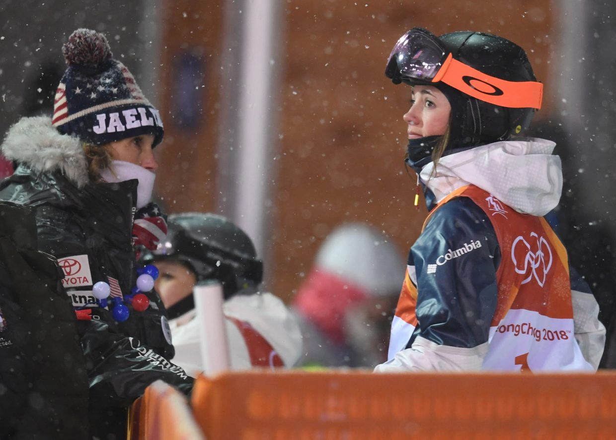 Jaelin Kauf speaks with her mother after being eliminated from the women's moguls competition at the 2018 Winter Olympics. Another photographer got a better version of this shot, with Kauf hugging her family. I wish I'd seen that moment, but I also really like the moment I did see. Kauf's family is often at the bottom of the course during her biggest events, and she's had many of post-competition chats with them. This was just another, but Kauf's face tells us instantly how things went.