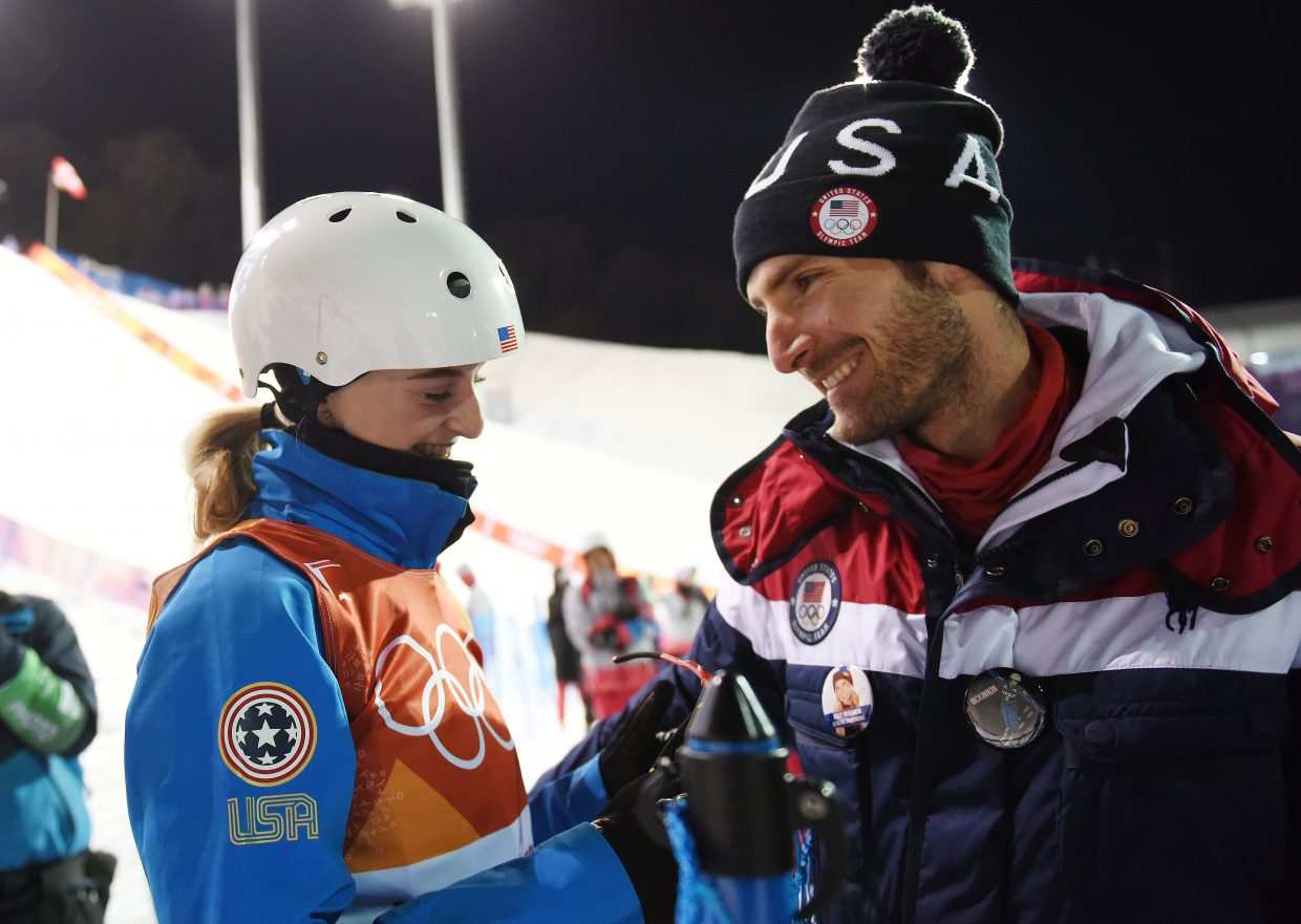 Kiley McKinnon and Taylor Fletcher share a moment after McKinnon qualified for the women's aerials finals at the 2018 Winter Olympics. I had actually been planning for several months to do a story on the couple. I'd hoped to have it ready to run on Valentine's day, but we were too slammed with other events, so I pushed it off. The plan was to meet them for a portrait, but I was walking back to the condo during the women's aerials event and made a spur of the moment decision to hike up to the venue and watch, figuring if nothing else it might be interesting to watch the event with Fletcher. I never know how
