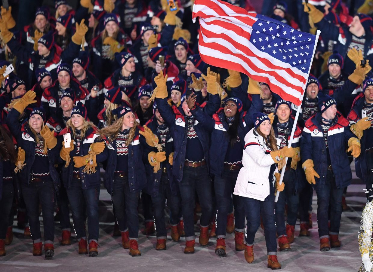 Erin Hamlin leads the United States athletes into the 2018 Winter Olympics Opening Ceremonies. I love these shots from the parade of nations. Marching in Opening Ceremonies is a major part of the dream for many athletes, and everyone's thrilled to be there.