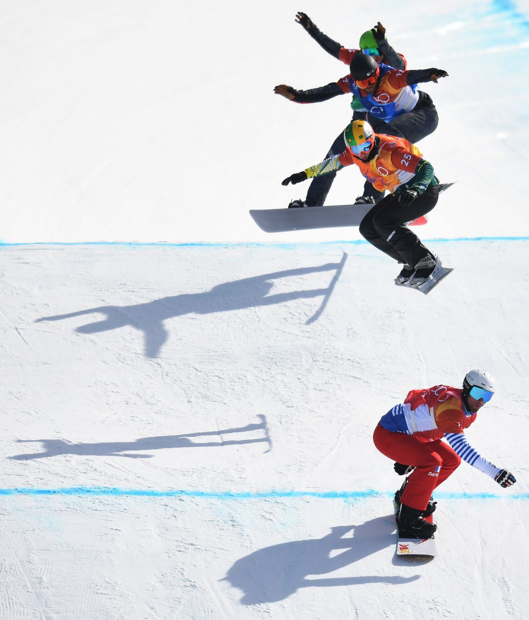 Snowboard cross is an awesome event to shoot. I love the symmetry of the racers coming over the jump.