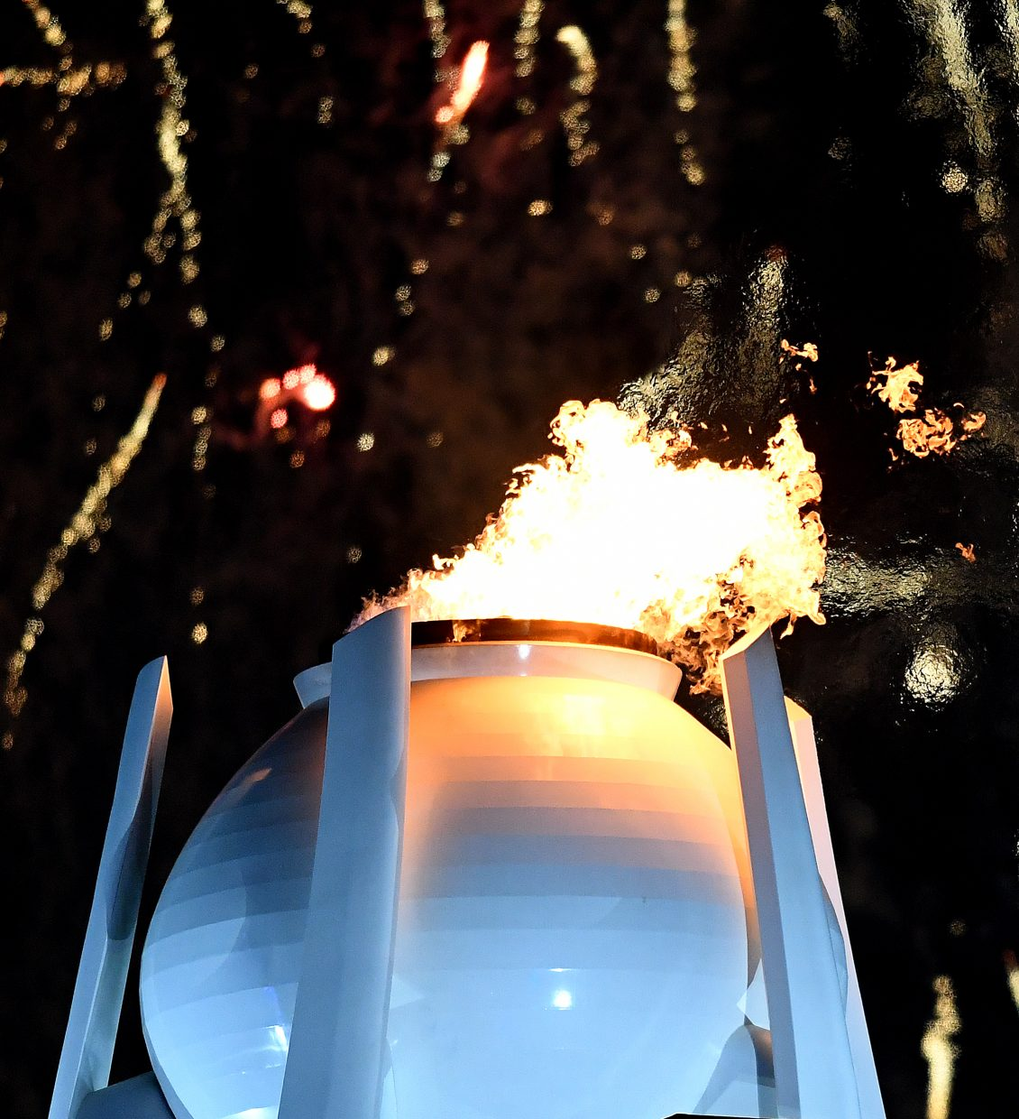 The Olympic flame at the 2014 Olympics was a large independent structure in the middle of a massive, open plaza. It was easy to isolate for photos. The flame in Pyeongchang, on the other hand, was sticking out of the top of the Olympic stadium. The view of the entire structure was obscured from my Opening Ceremonies seat, so to trim out some of that clutter I had to crop just the top part to get a dramatic photo.