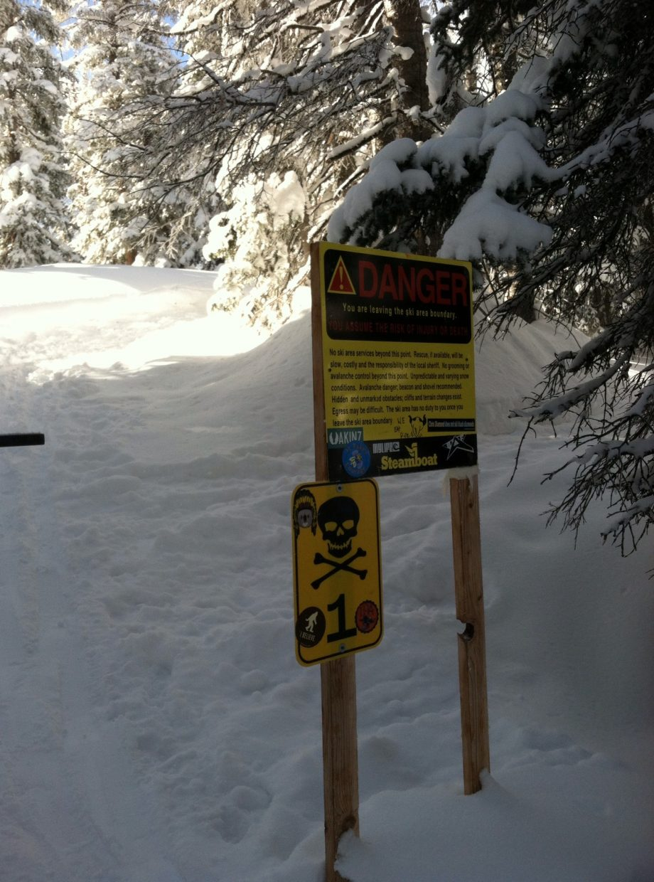 A shot of a warning sign, letting skiers know they are getting off the correct path.