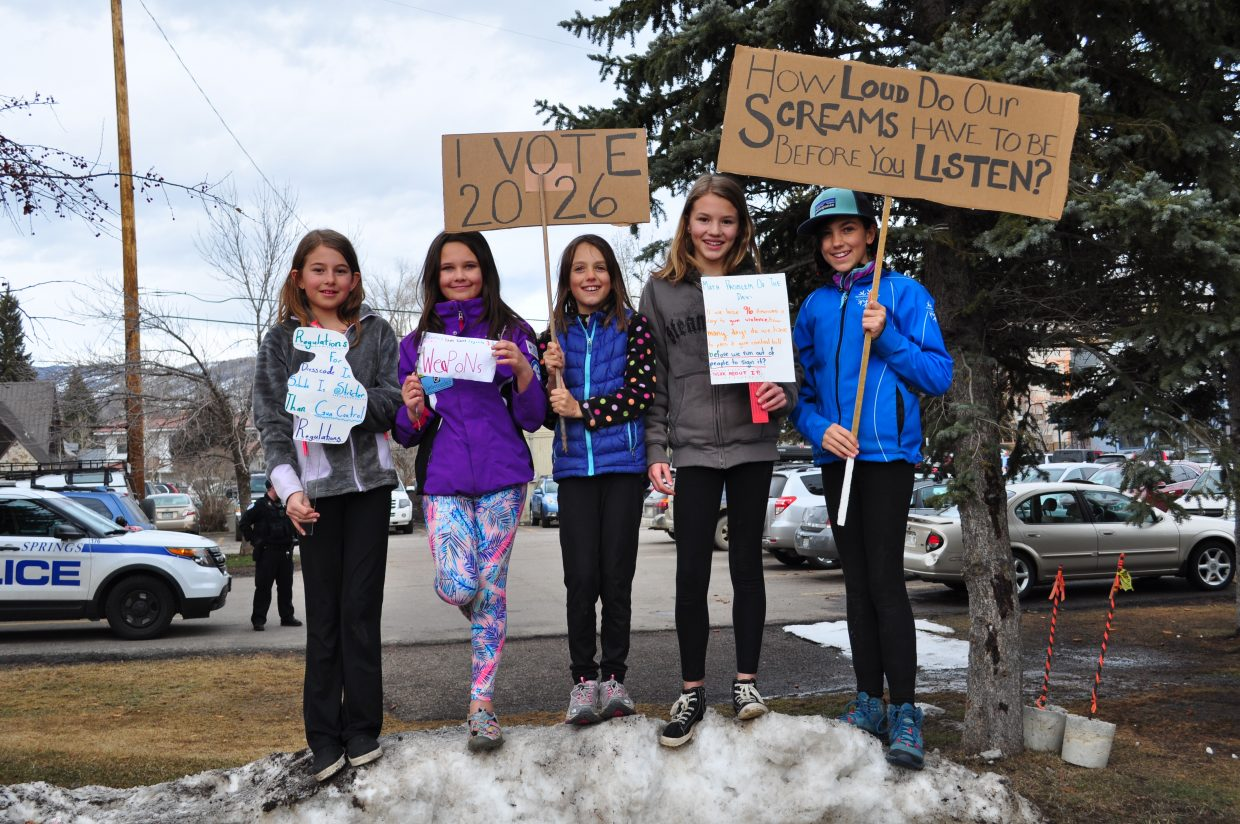 From left, Lucy Capra, 10; Shea Speer, 9; and Miela Brinkman, 9 joined the demonstration from Soda Creek Elementary School. From right Wren Capra, 12 and Sloane Speer, 12  are Steamboat Springs Middle School students. They held signs and joined the March for Our Lives demonstration on the courthouse lawn in Steamboat Springs.