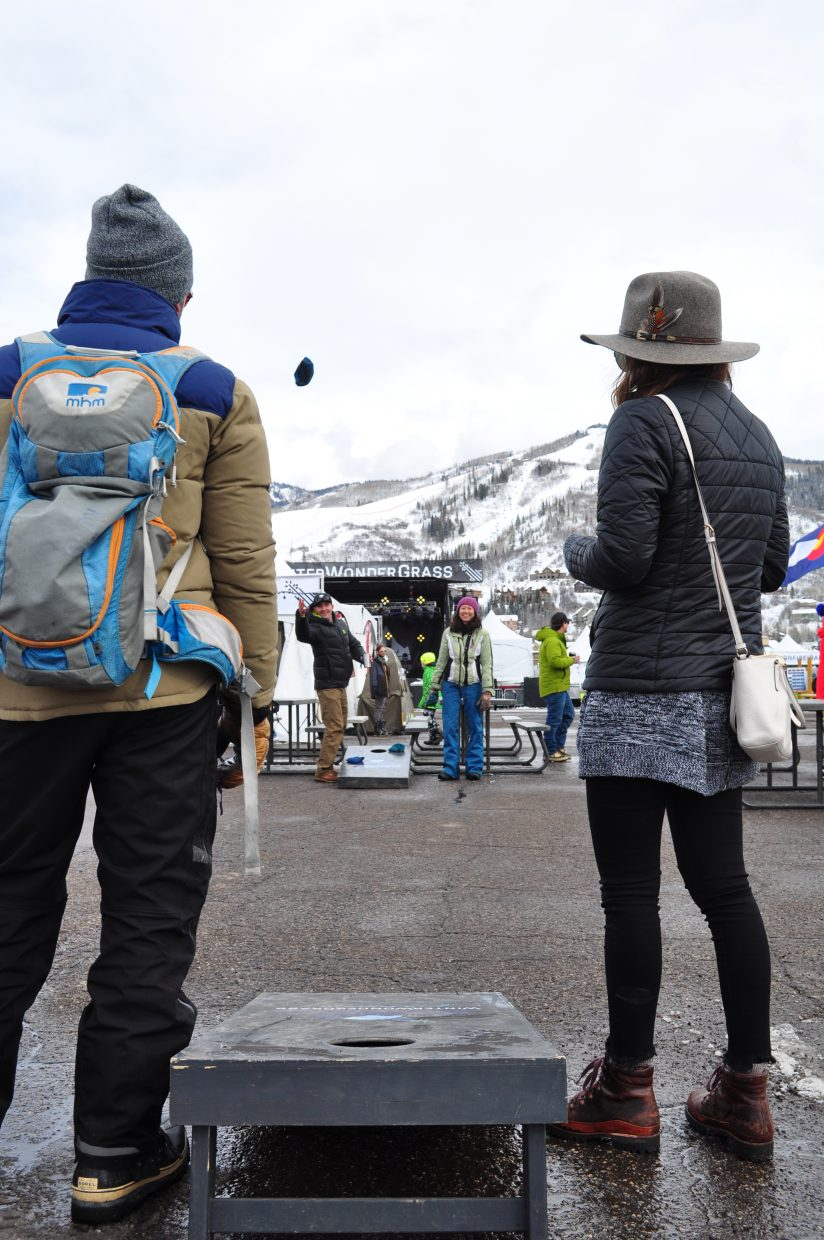 Festival attendees play cornhole before music starts on the main stage at WinterWonderGrass Bluegrass Festival in Steamboat Springs.