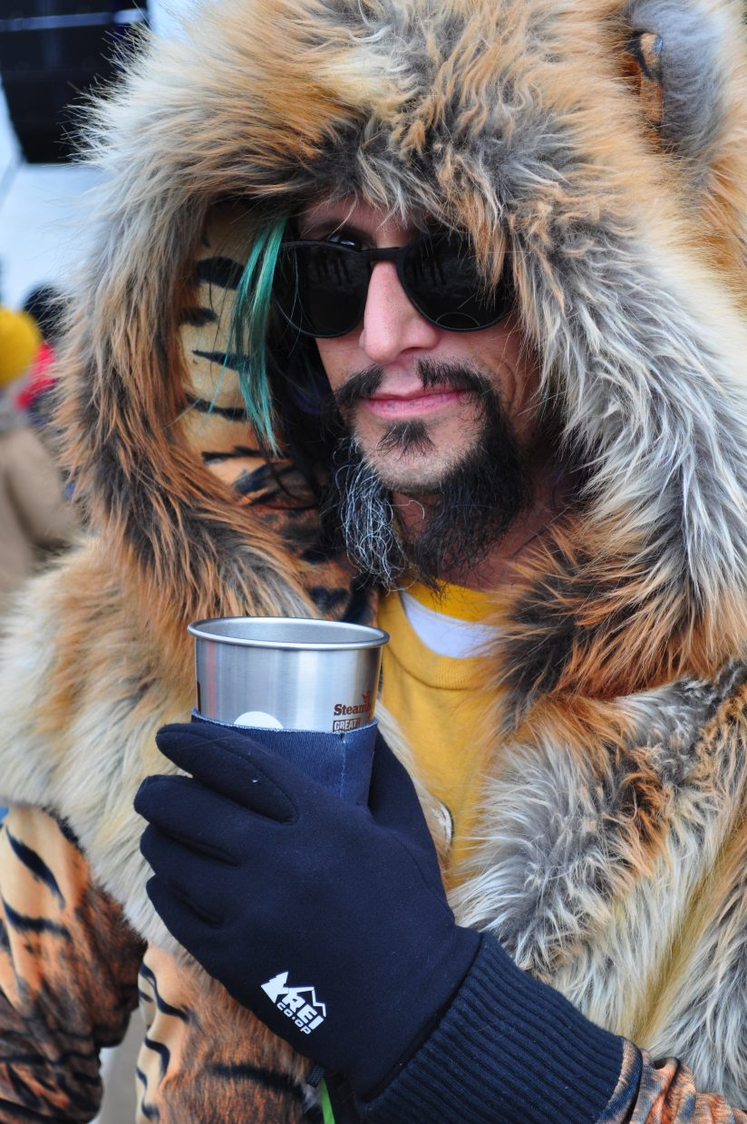 Parker Roe, of Boulder, bundles up for a cool day at WinterWonderGrass on Friday in Steamboat Springs.