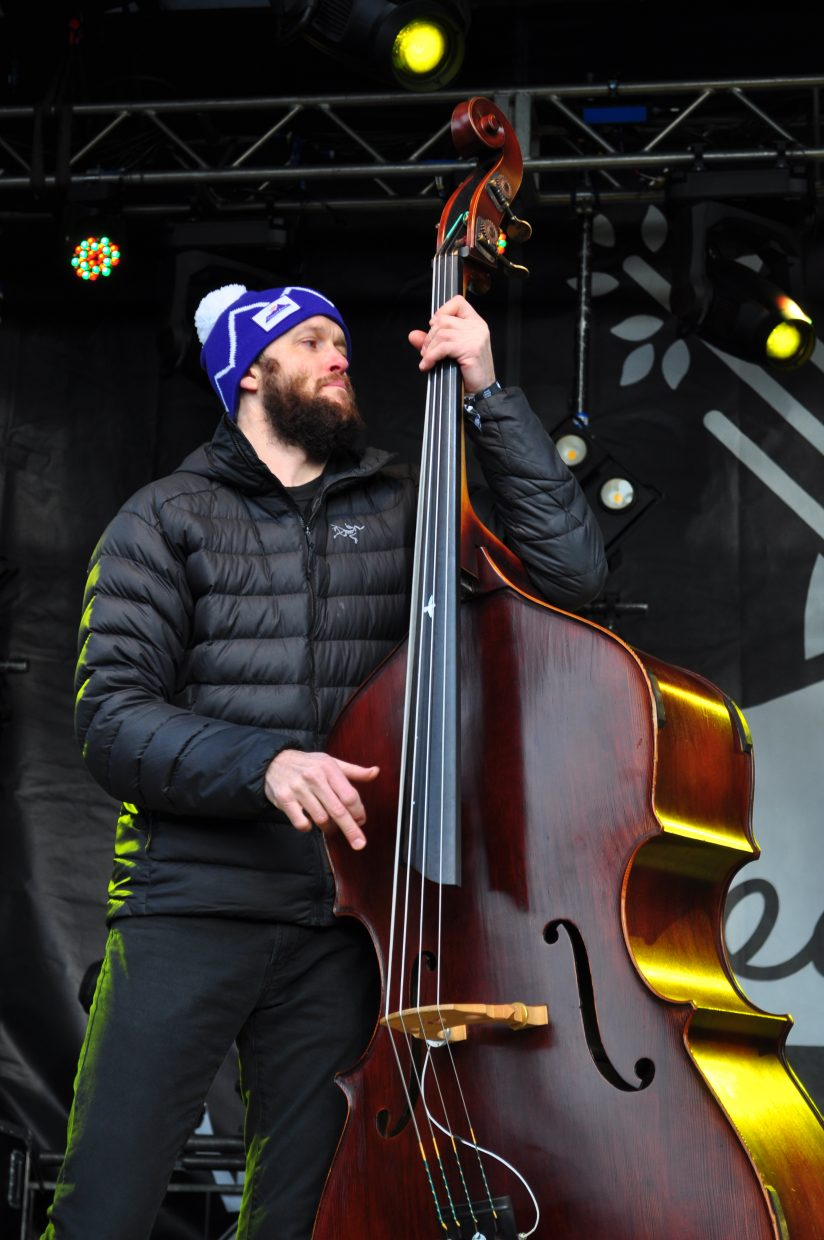 The Lil Smokies bass player Scott Parker plays Main Stage at WinterWonderGrass on Saturday in Steamboat Springs.