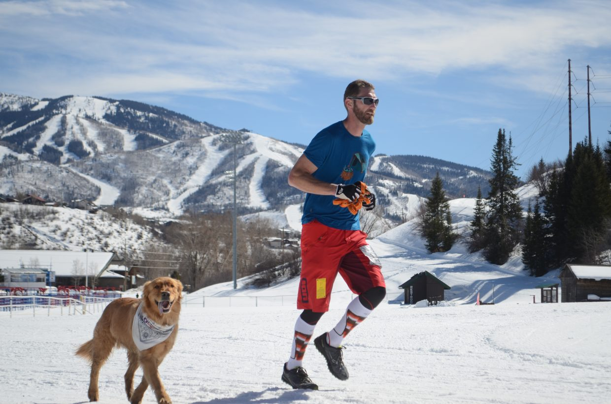 Dalls Bailes running with his dog in Saturday's 27th annual Steamboat Penathlon at Howlesen Hill.