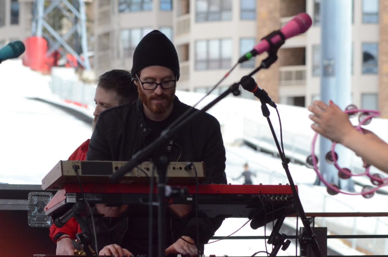 Chris Brouwers playing both trumpet and keyboards with Turkuaz.