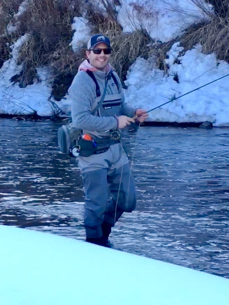 A man enjoys a nice day fishing on the Yampa River.