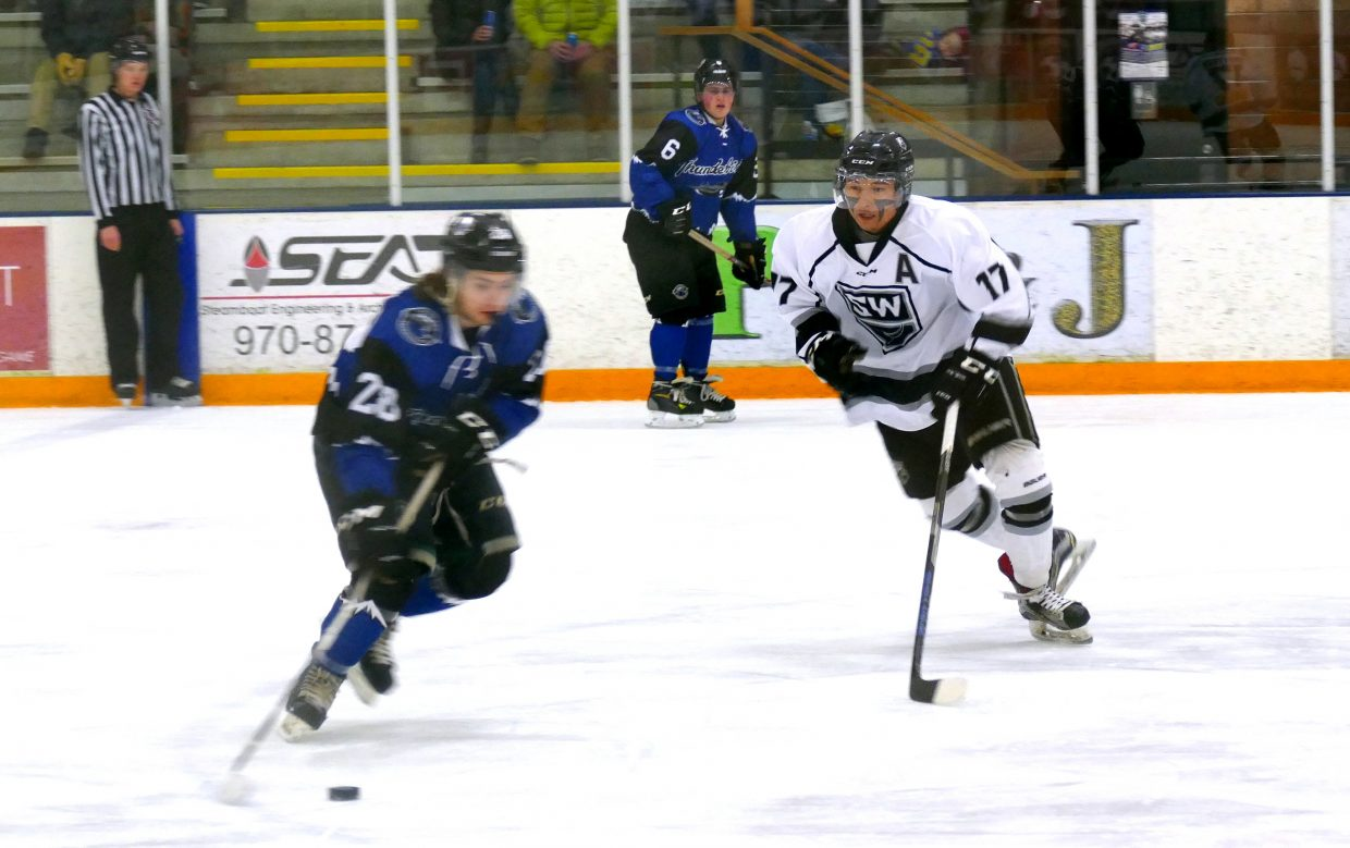 Donny Nordstrom with the Steamboat Wranglers goes for the puck in Friday night's 9-1 victory over the Colorado Thunderbirds, at Howelsen Ice Arena.