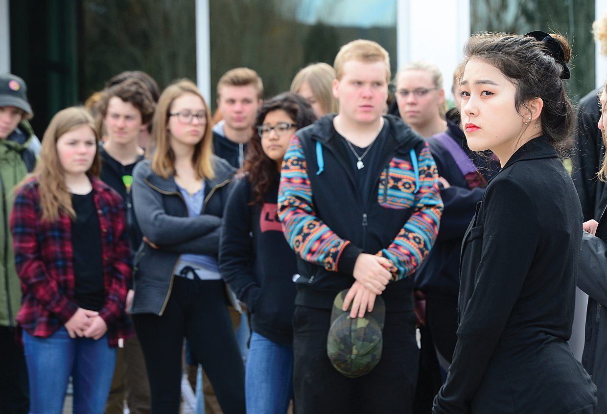 Samantha Lee stands in silence during a walkout Wednesday morning at the Steamboat Springs High School. Lee was part of a group of between 150 and 200 students who took part in the event. The walkout was to protest gun violence and to remember the victims of the shooting at the  Marjory Stoneman Douglas High School in Parkland, Florida, that took the lives of 17 people.