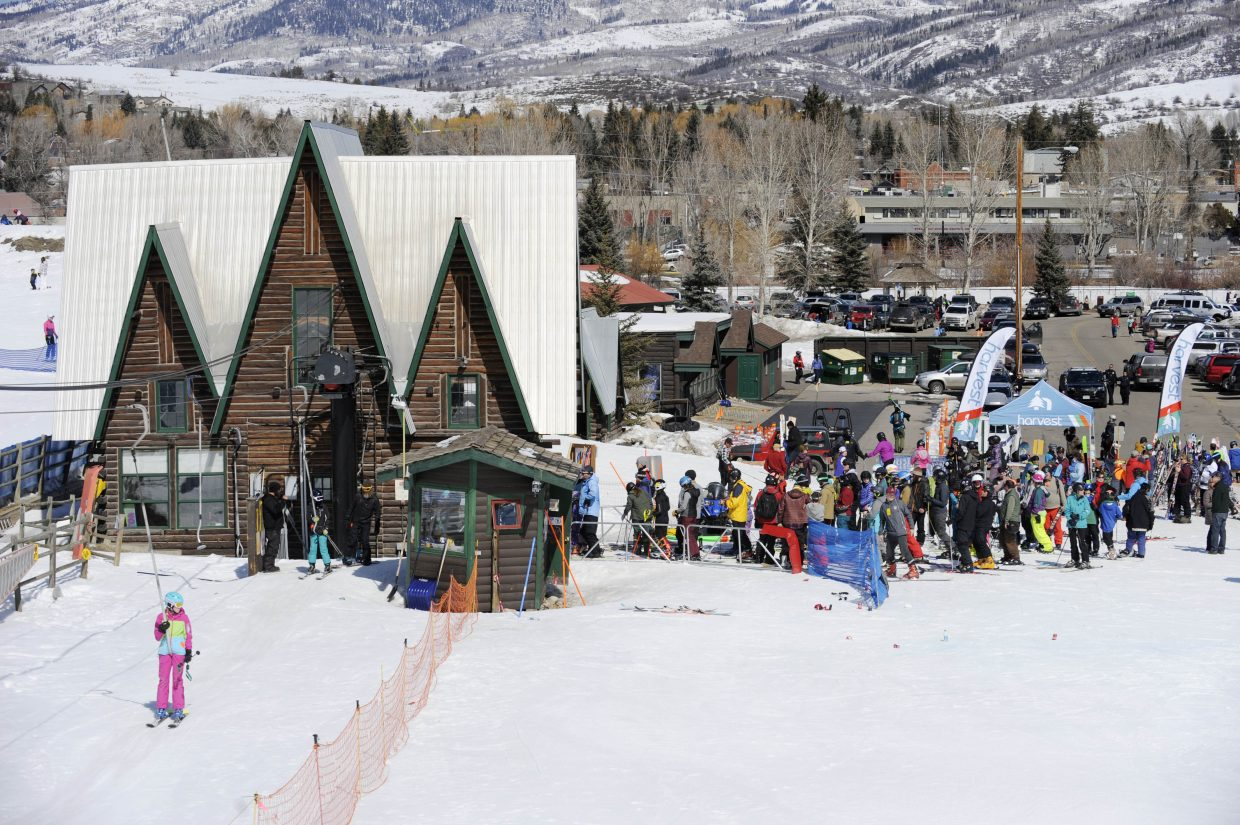 Skiers line up at the Poma lift during the final Free Ski Sundays event of the season at Howelsen Hill.