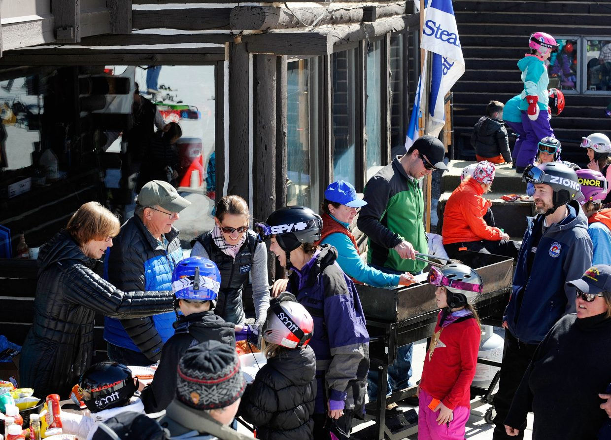 Steamboat Springs City Council members pass out free hot dogs during during the final Free Ski Sundays event of the season at Howelsen Hill.