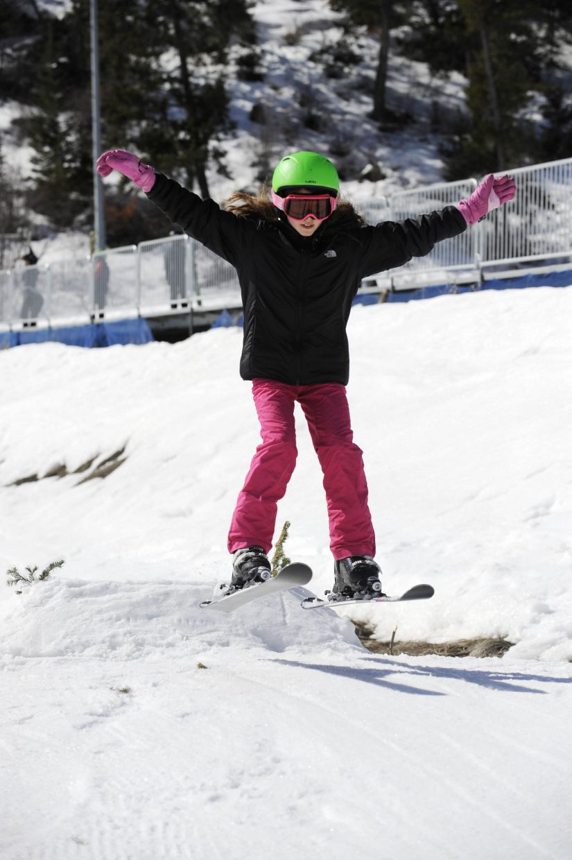 Alli Arnold of Houston, Texas, tries out ski jumping during the final Free Ski Sundays event of the season at Howelsen Hill.
