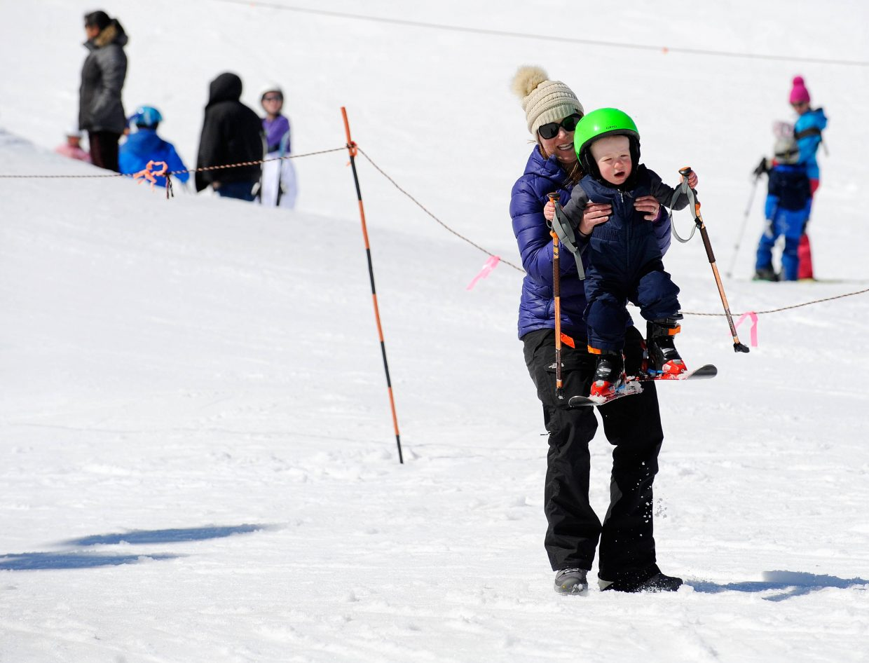 Steamboat Springs resident Carrie Thompson teaches her 21-month-old son Eli how to ski during the final Free Ski Sundays event of the season at Howelsen Hill.