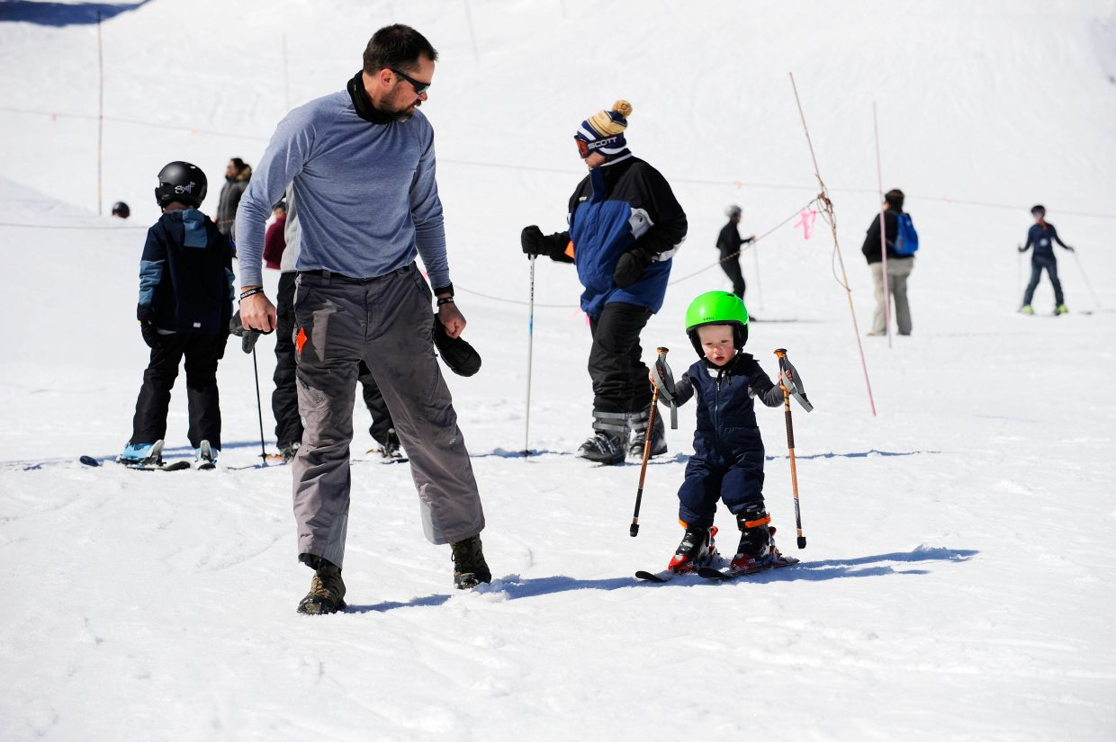 Steamboat Springs resident Kevin Thompson teaches his 21-month-old son Eli how to ski during the final Free Ski Sundays event of the season at Howelsen Hill.