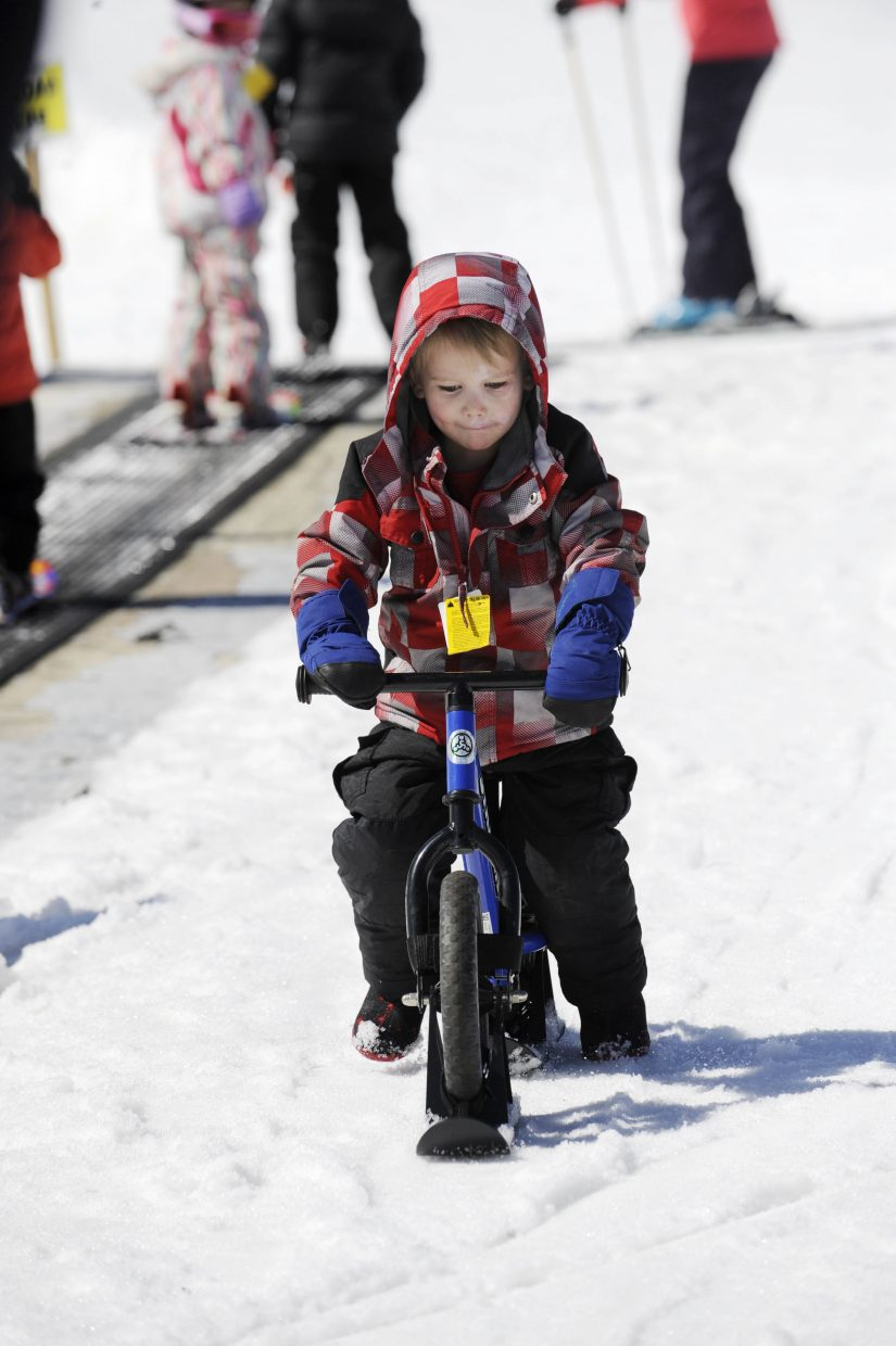 David Sloan rides a Strider bike during the final Free Ski Sundays event of the season at Howelsen Hill.