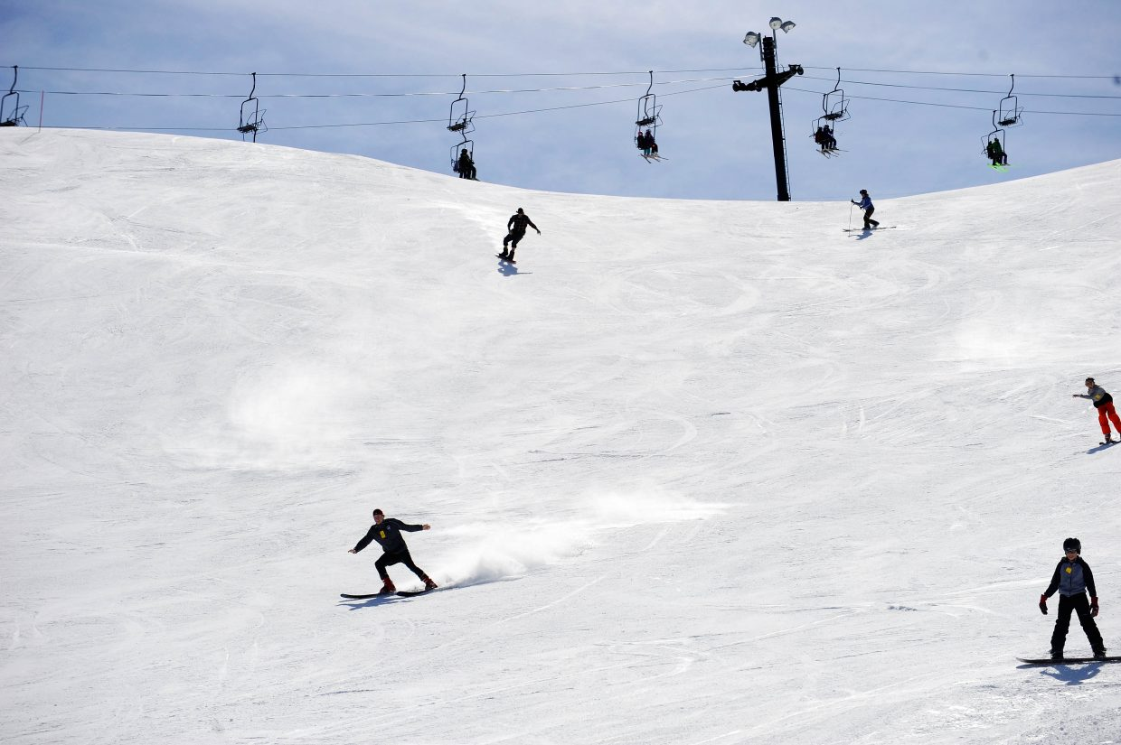 Skiers and snowboarders come down The Face during the final Free Ski Sundays event of the season at Howelsen Hill.