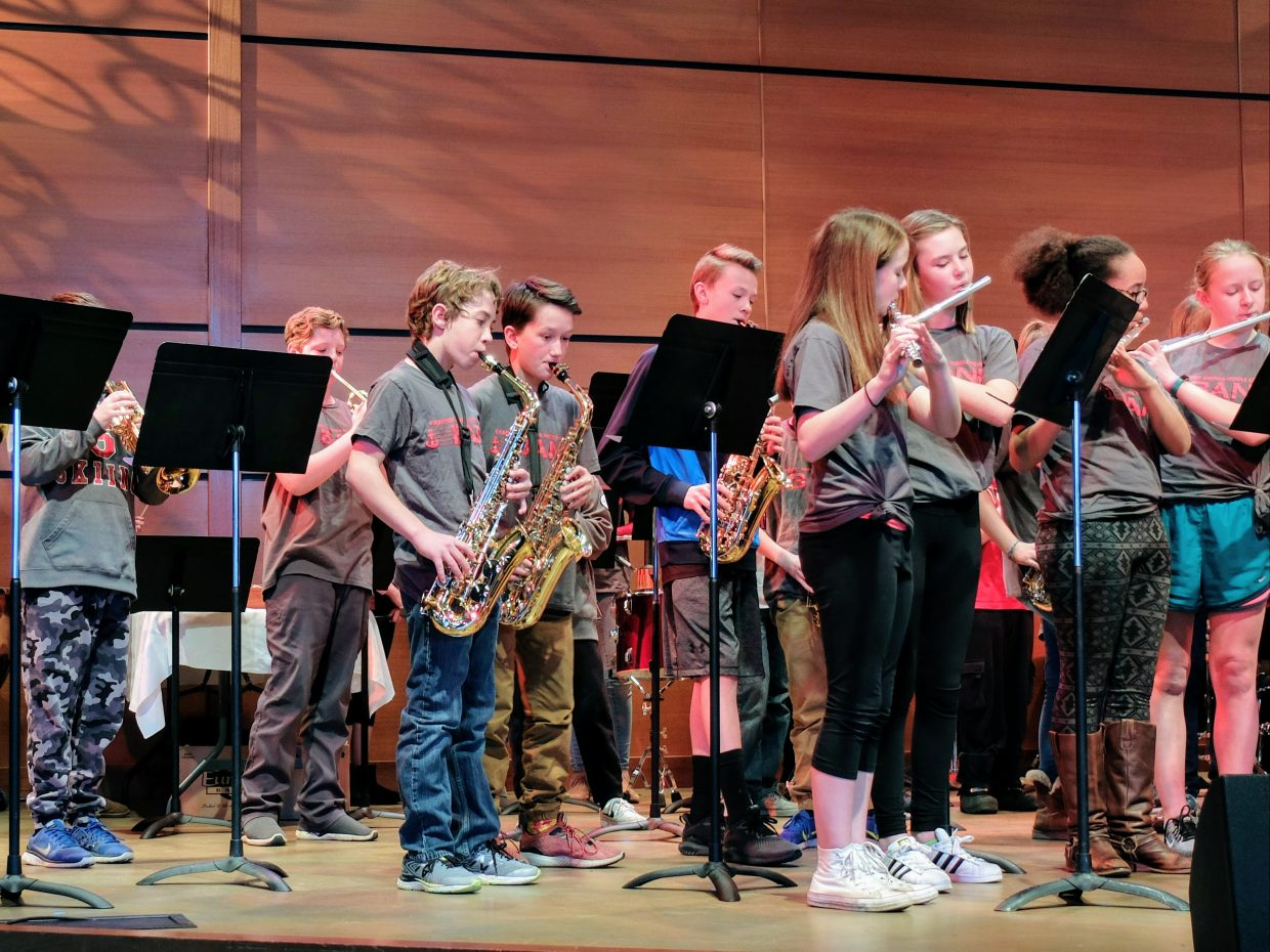 Students from Steamboat Springs Middle School and Emerald Mountain School perform on stage at Strings Pavilion after months of mentorship through the Strings School Days program.