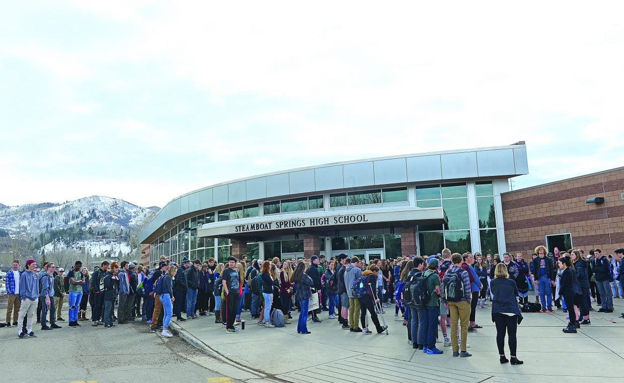 Students at Steamboat Springs High School gather outside during a walkout Wednesday morning to protest gun violence in the aftermath of the shooting at the Marjory Stoneman Douglas High School in Parkland, Florida, that took the lives of 17 people.