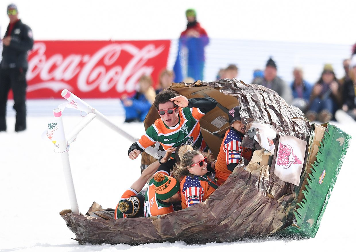 The cowpie hits the fan Saturday as the Steamboat Rugby club's craft tips over during the annual Cardboard Classic event at Steamboat Ski Area.