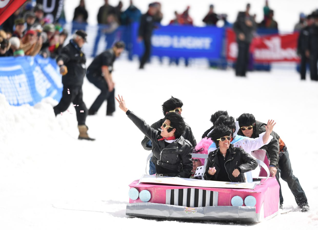 "The ""Traveling Elvi"" make their way down the Cardboard Classic course at Steamboat Ski Area."