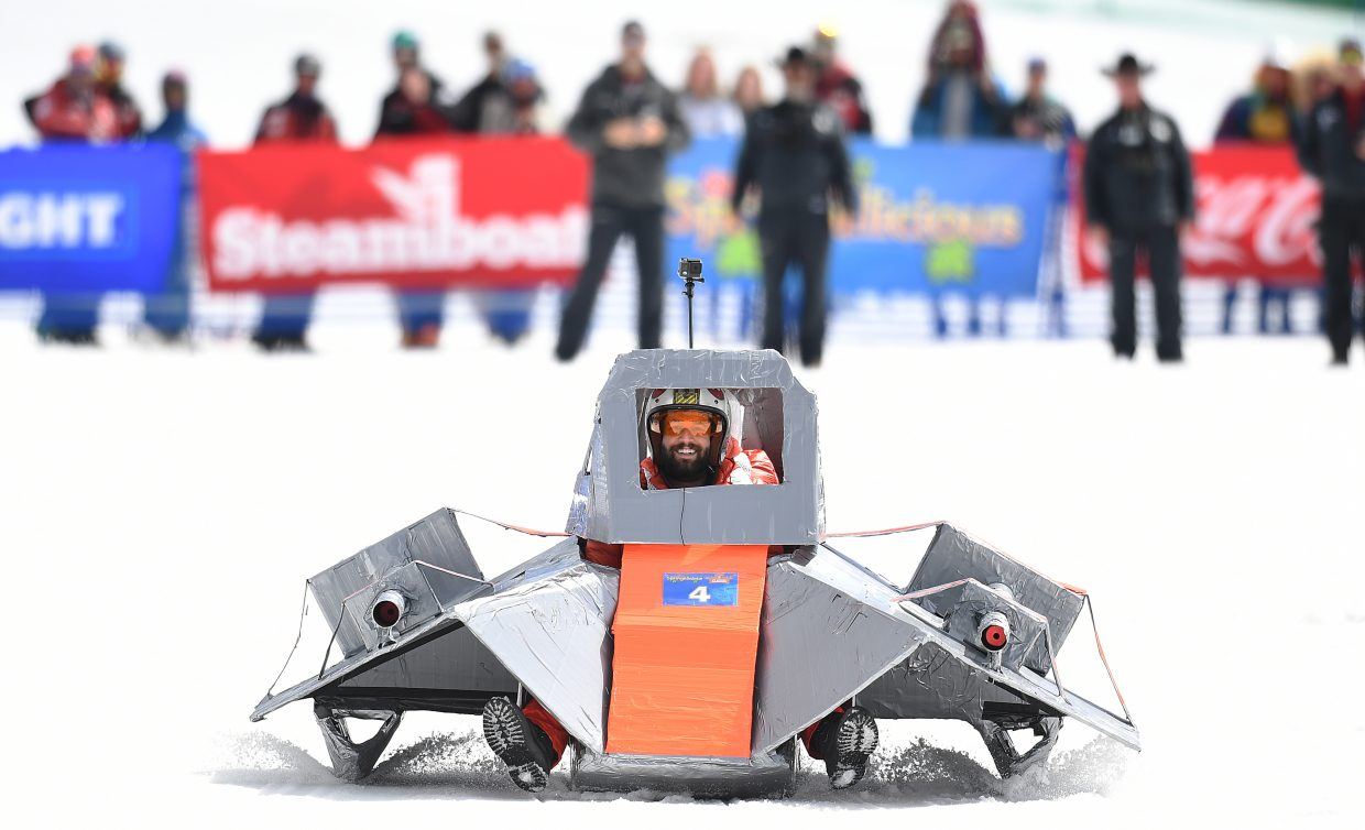 Nick Bastoni, from Dallas, takes aim at an Emperial AT-AT walker from his T-47 airspeeder while trying to defend the Rebel base on Hoth on Saturday during the Cardboard Classic at Steamboat Ski Area.