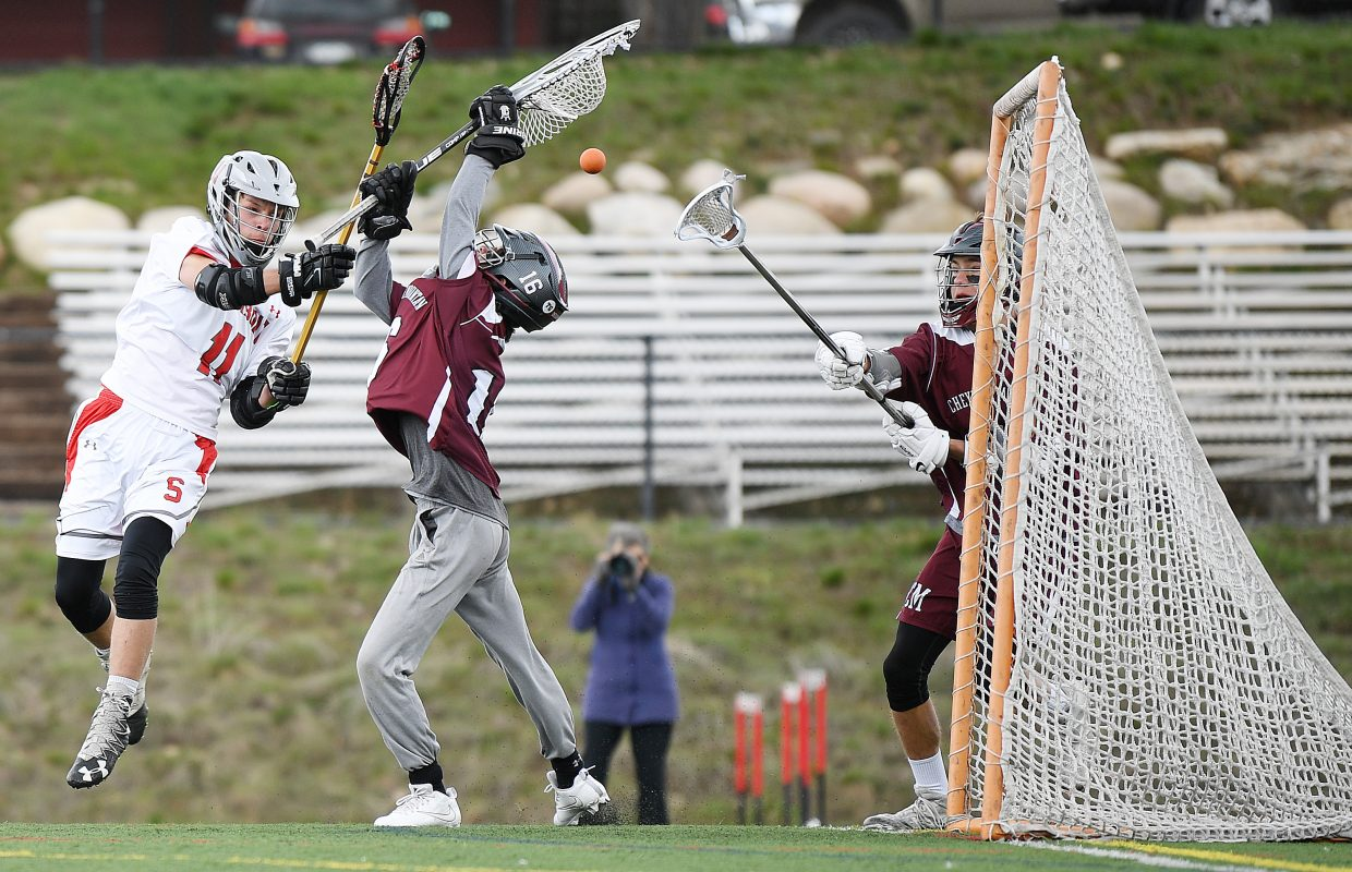 Steamboat junior Tallak Mhyre lets loose a shot in front of the Cheyenne Mountain goal on Saturday. He didn't connect on that one, but the Sailors did get enough scoring for a 7-6 victory.