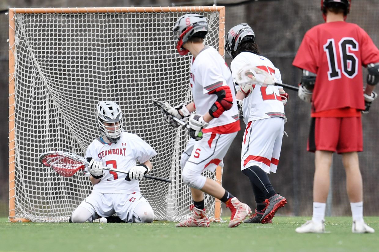 Steamboat goalie Griffn Maltby knocks a shot down in front of his legs Thursday against Glenwood Springs.