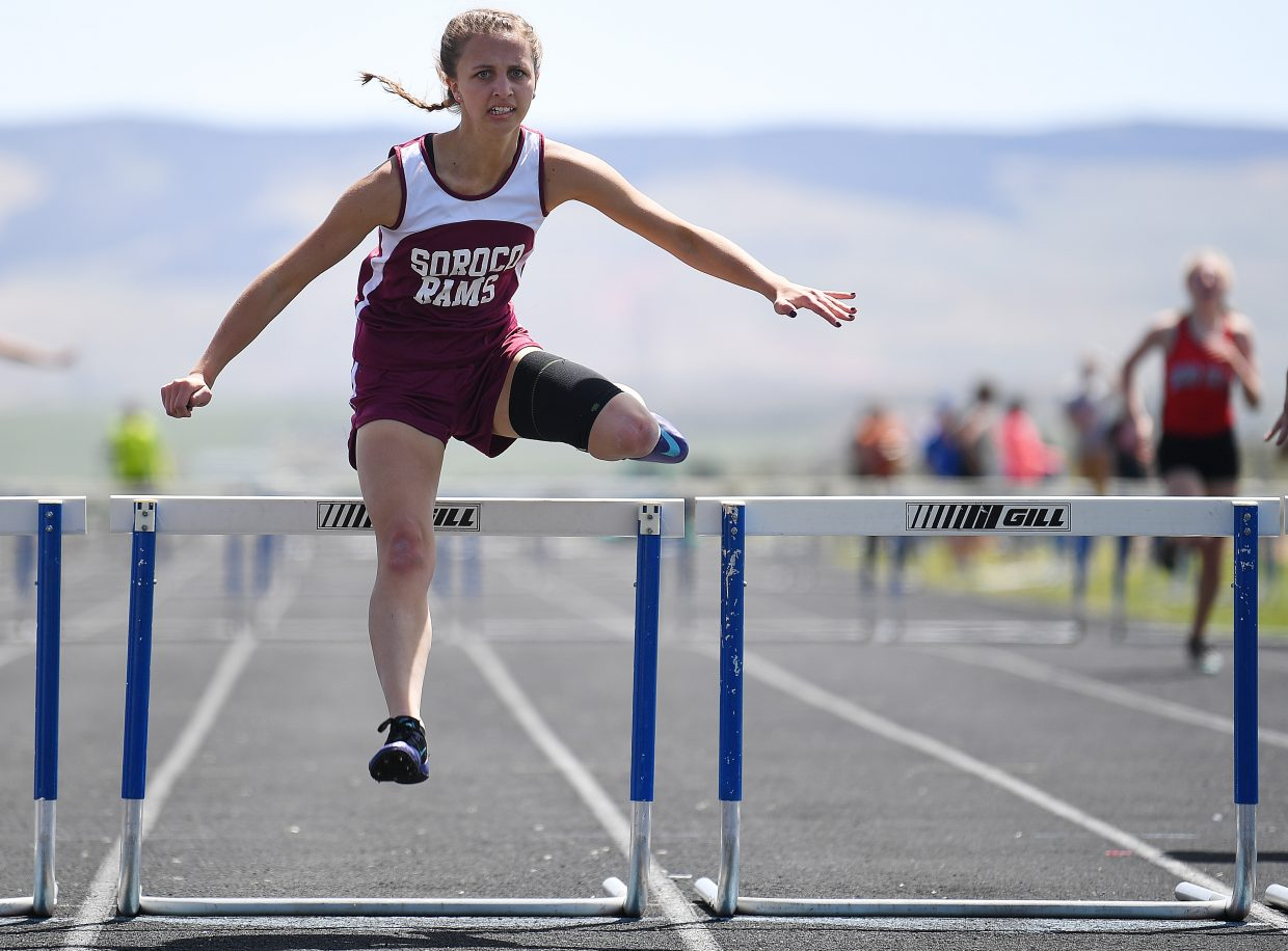 Soroco senior Charlee Veilleux leaps the final hurdle in the girls 300-meter hurdle event on Friday at Moffat County High School.