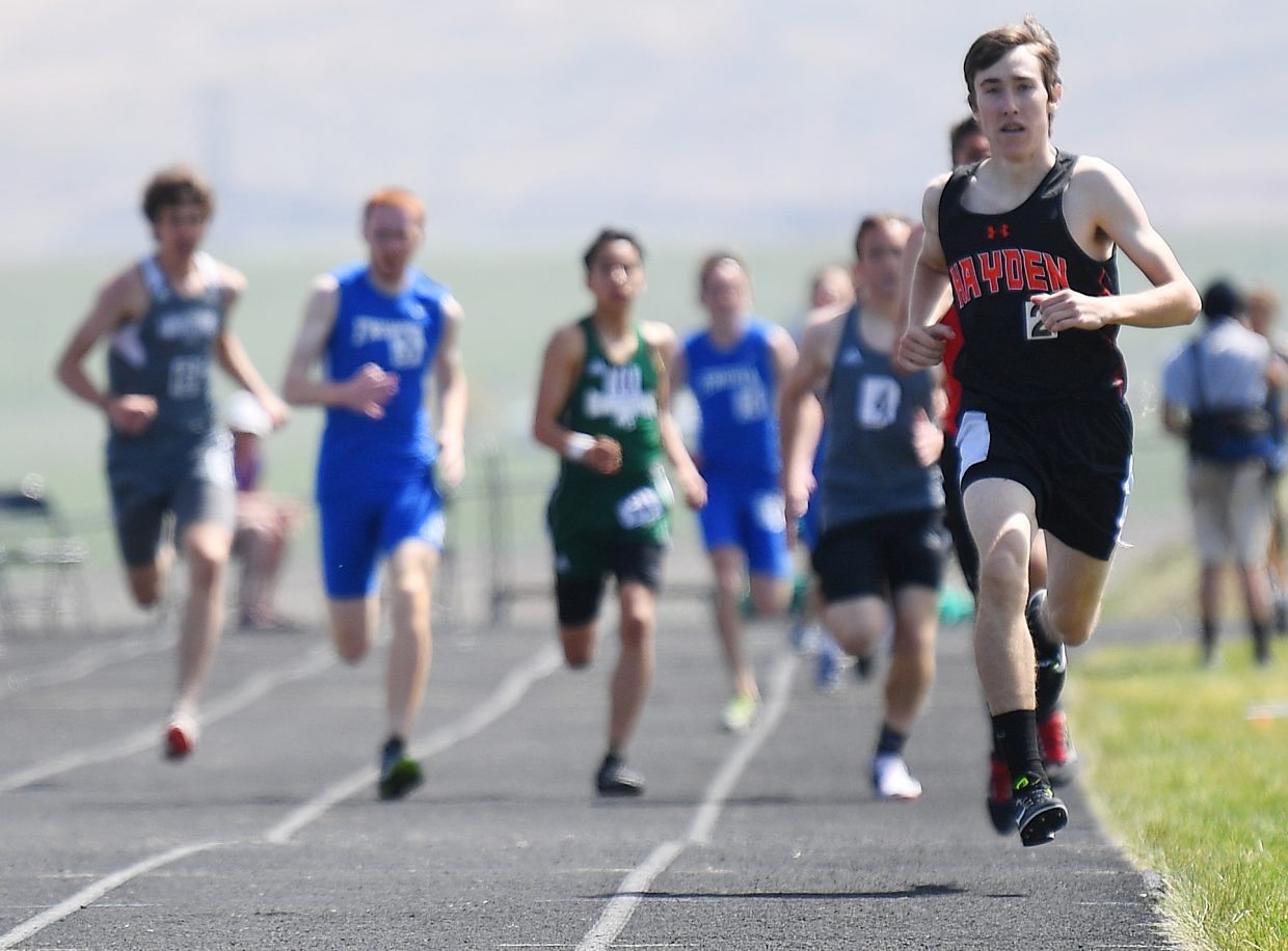 Hayden's Chris Carrouth leads the pack toward the finish line Friday in the boys 800-meter race at Moffat County High School. He went on to win the event.