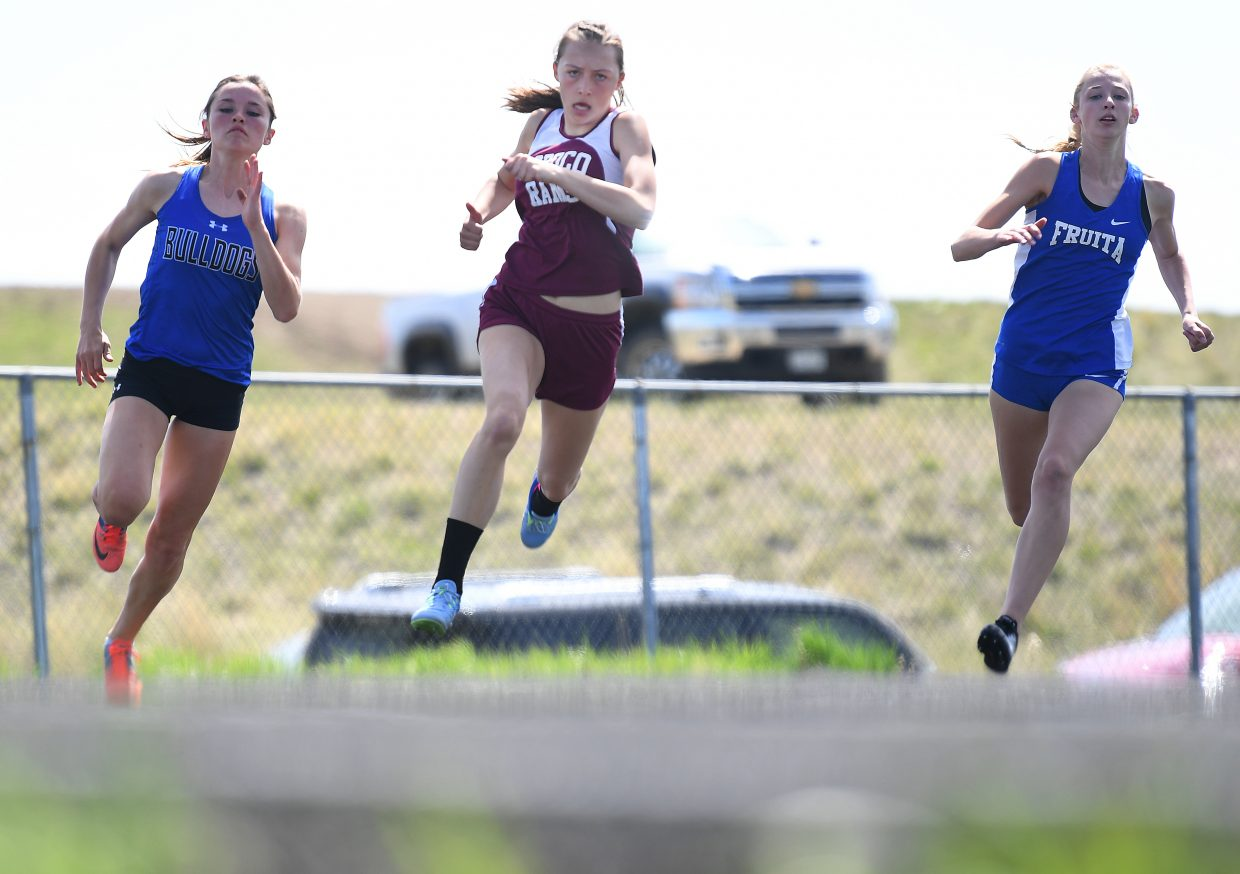 Soroco's Kourtney Bruner charges around the corner during the 200-meter dash last month at Moffat County High School.
