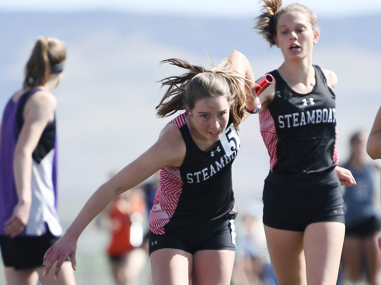 Steamboat Springs runner Winter Boese takes the baton from Isabelle Boniface on Friday during the girls 1,600-meter relay at the Clint Wells Invitational in Craig.