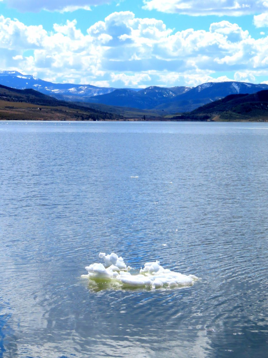 Snow still floats on top of the Satgecoach Reservoir.