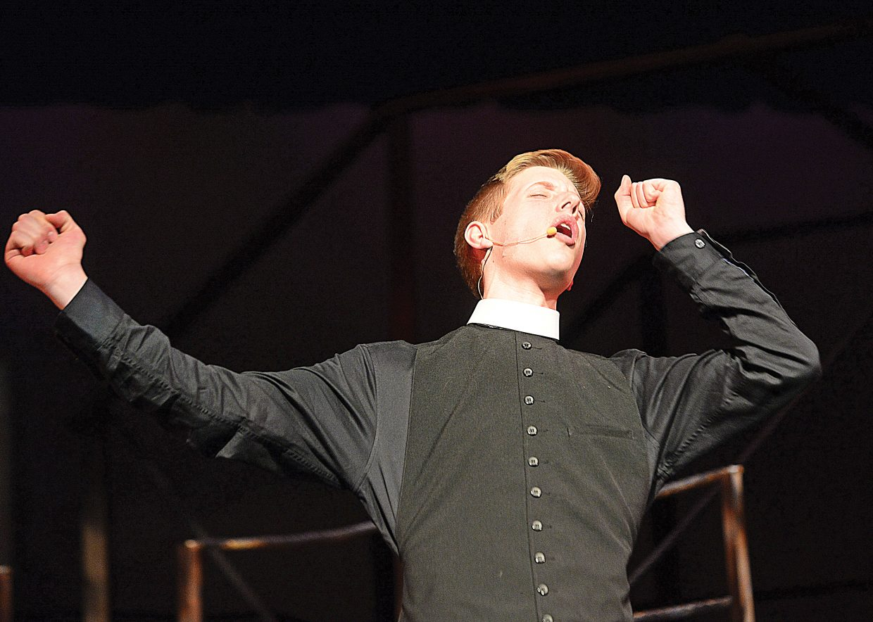 Ben Heil plays the part of Reverend Moore during a rehearsal for
