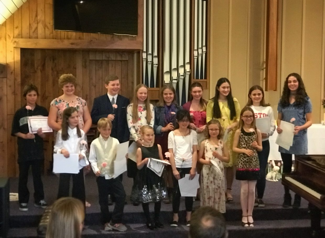 Children perform during the Honors concert Monday, April 16, 2018.