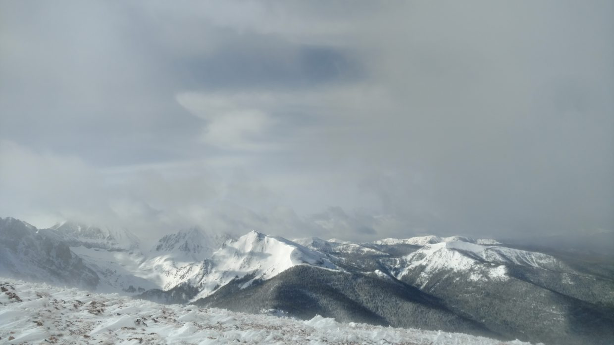 A shot of the peaks at Cameron Pass, going up into the misty clouds.